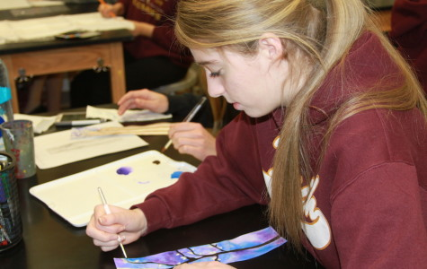 Conservatory student Jordyn Dunseath works on a water color piece during her art class.