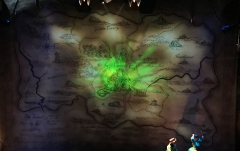 Photo caption: The Emerald City brightens the stage during intermission