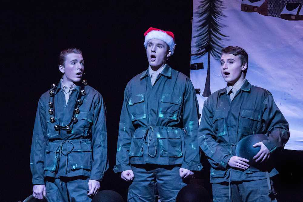 Photo caption: Christopher May (right) sings a Christmas tune in one of his favorite musicals