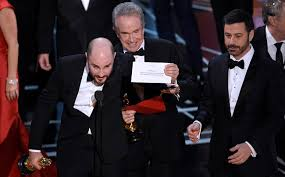 Photo caption: Producer of 'La La Land', Jordan Horowitz, holds up the correct envelope for the winner of Best Major Motion Picture, 'Moonlight'.