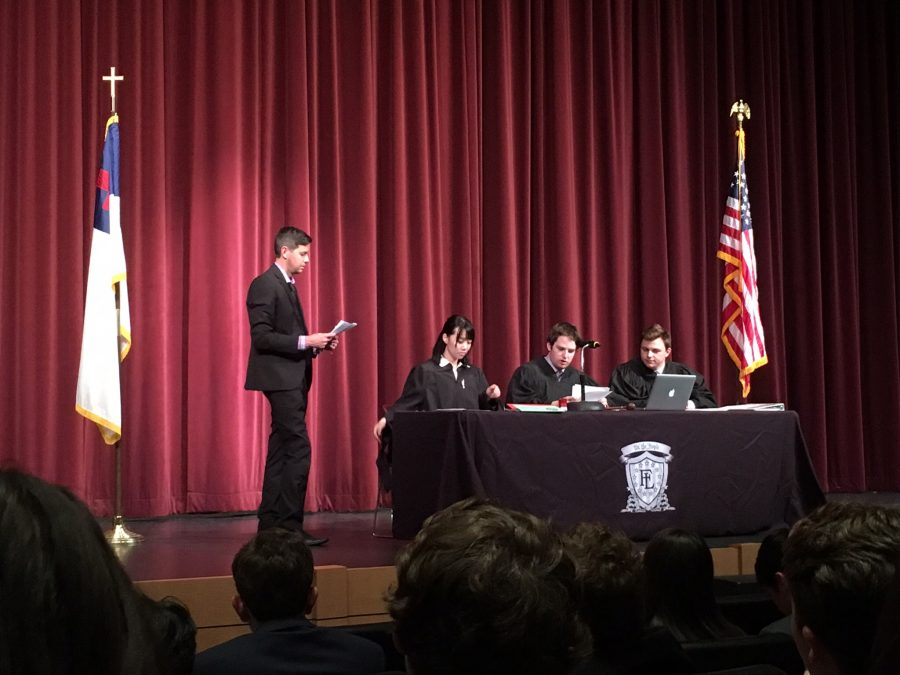 Mr. Watts discussing with Hart Roberts, Zac Anderson, and Jia Chen, the Three Justices about the bills that were passed in Model Congress.
