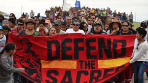 Photo caption: Native Americans fought against the pipeline building, since it's on their own ground. Credit: billmoyers.com