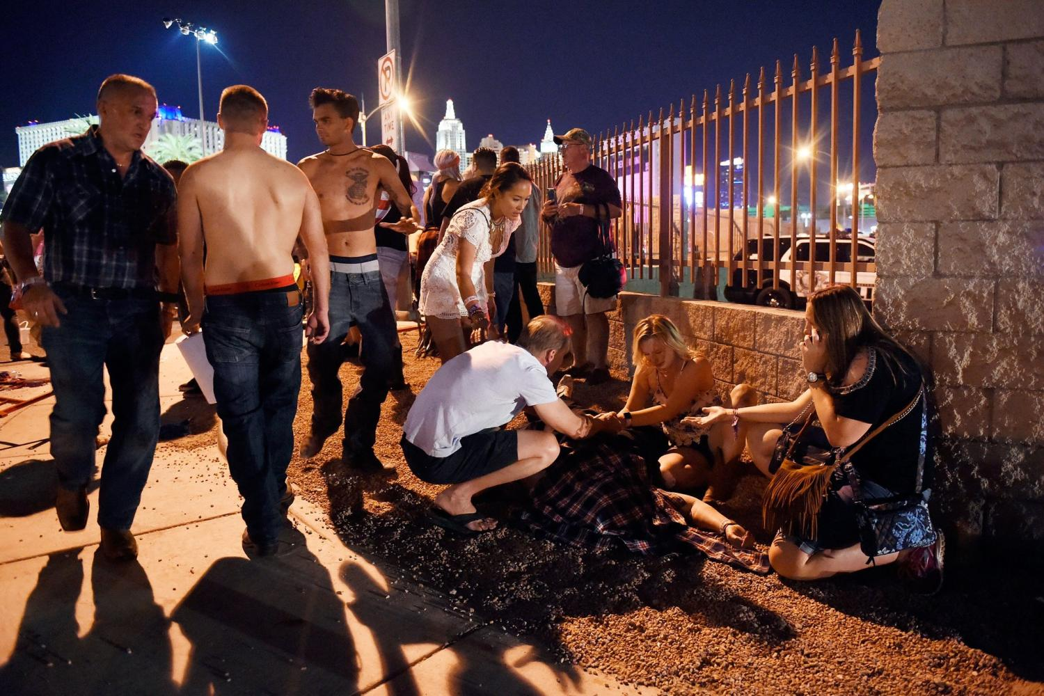 Festival goers attend to an injured after the attack.