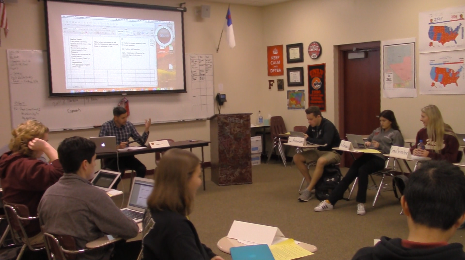 Advisor, Ryan Watts, leads his AP US Government class in a formal debate on a current issue in America