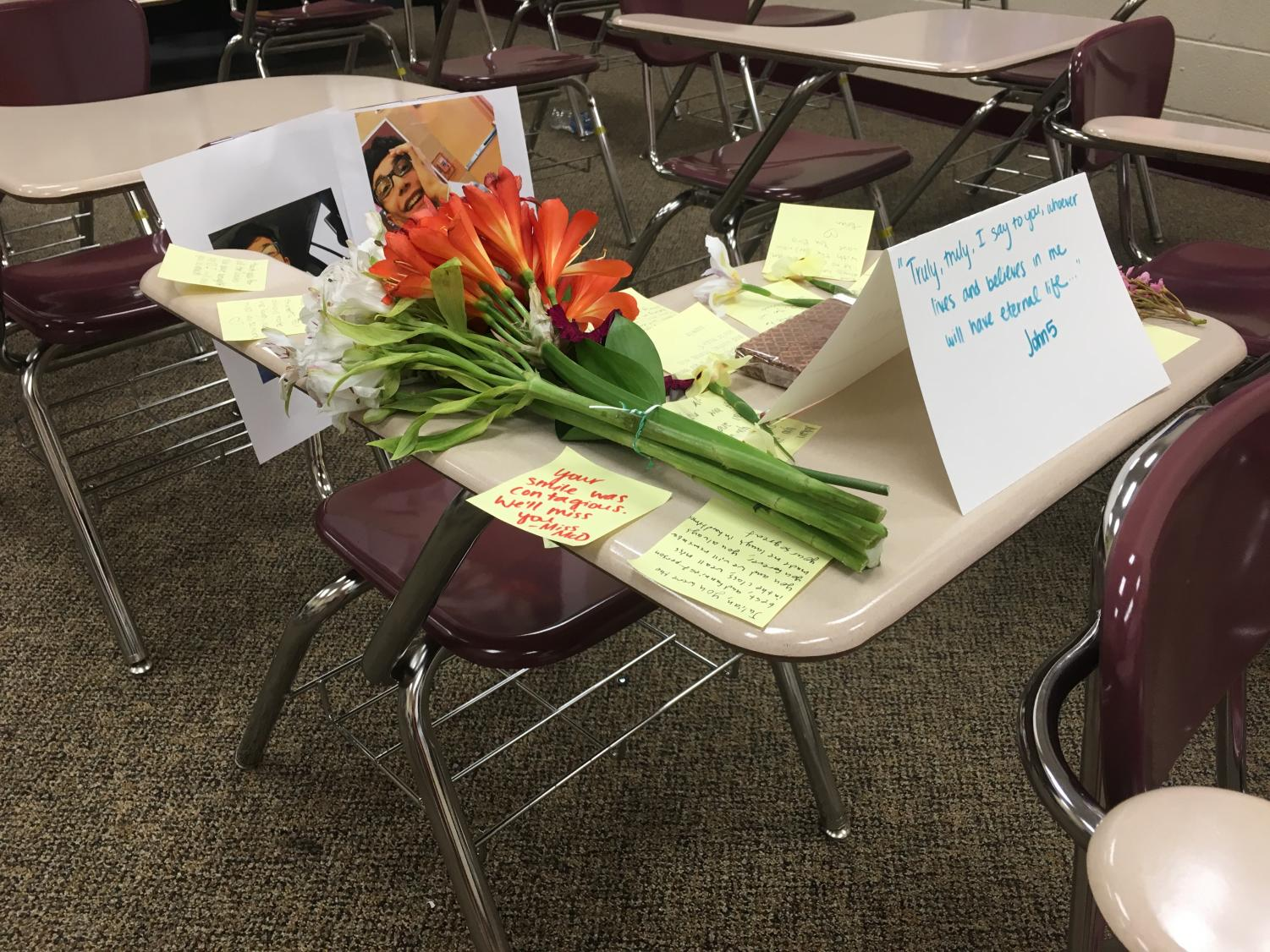 The students in one of Julian's classes set up a memorial at his desk, proving he will be missed by all that knew him.