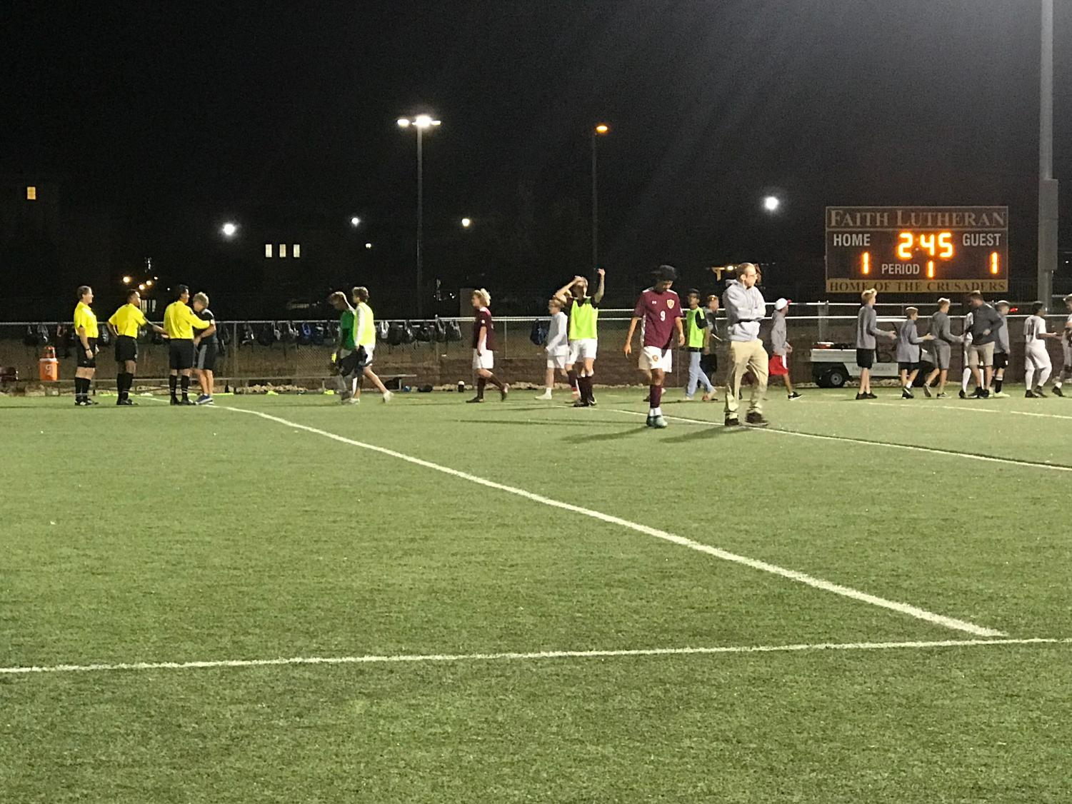 Both teams walk off the field after a match that took overtime to decide a victor.
