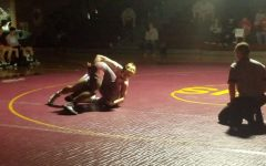 Varsity wrestling makes team history in consecutive weeks