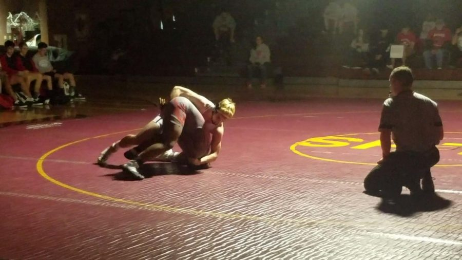Connor+Bourne%2C+a+2x+state+champion+and+Greco+Roman%2F+Cadet+Freestyle+All+American%2C+wrestling+against+Renaud+Hunter+in+his+match+against+Coronado.+He+would+win+by++fall+in+a+minute+and+four+seconds.+