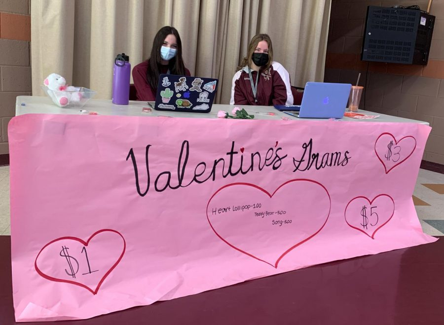 Student council members sitting at their throne of Valentine power.