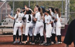 Varsity Girls Celebrate After a Homerun